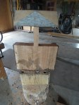 old pine chair seat on stump ET